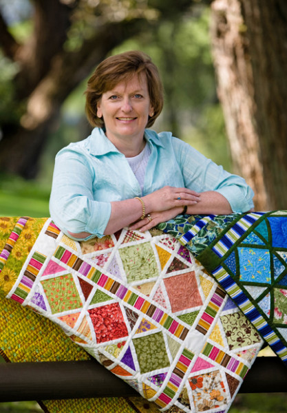 Joan Ford with Stained Glass Quilt