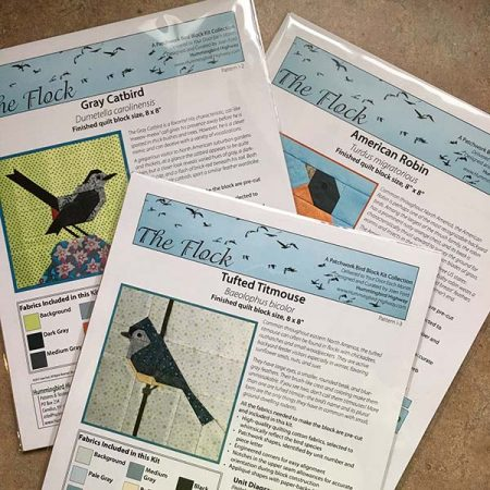 The FLOCK bird block kits. Precision pre cut fabrics are included in each bird block quilt kit