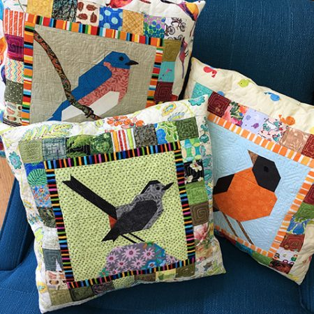 The FLOCK Bird block quilt kits include all the fabric need to make the patchwork pieced bird blocks. Bonus patterns for members