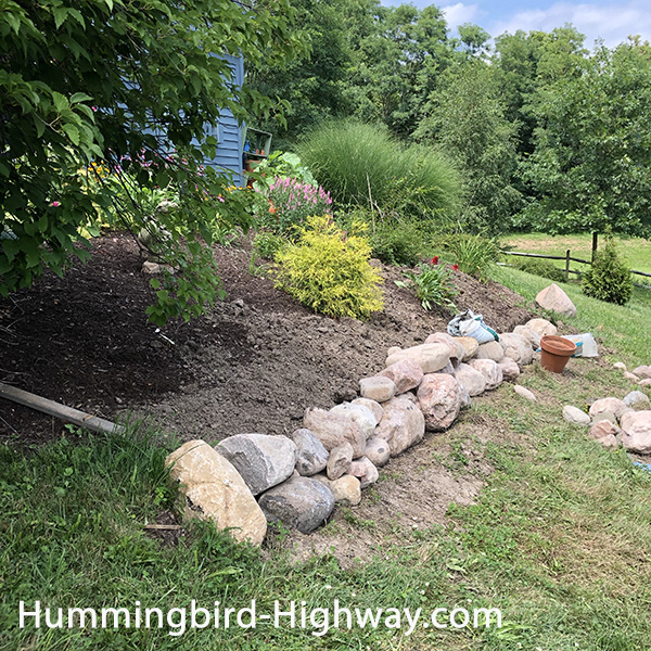 Garden retaining rock wall